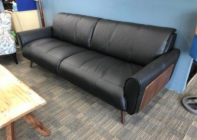 Natuzzi Black Leather Sofa with Walnut Panels