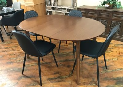 Walnut Oval Dining Table and Black Diamond Tufted Dining Chairs
